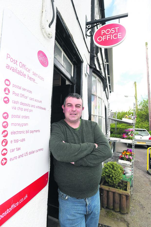 This Is Wiltshire: Adrian Dunn says business at the relocated Bromham Post Office has been slow