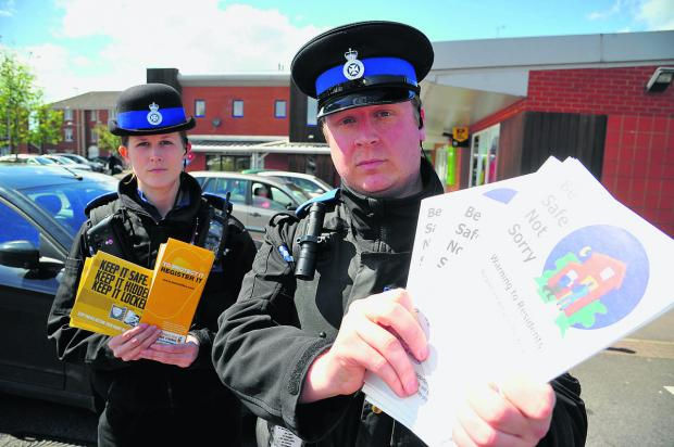 This Is Wiltshire: PCSOs Lee Hare and Ashlee John hand out 'lock it up' flyers