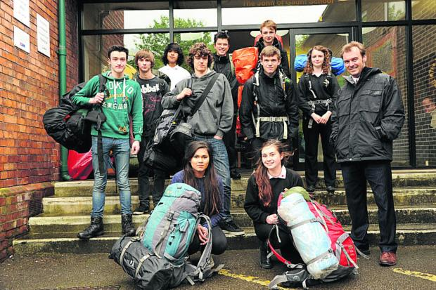 This Is Wiltshire: Team leaders Leisha Mortimer and Annie Littlejohns with the John of Gaunt School teams before they set off for the Ten Tors challenge with tutor Stuart Gray. (48758) Picture by Trevor Porter