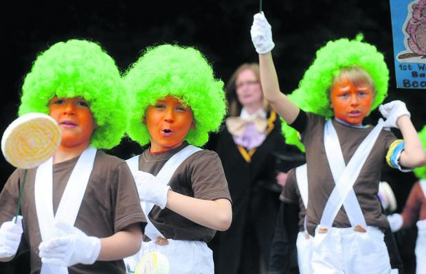 This Is Wiltshire: Ooompa Loompas on the march at last year's Royal Wootton Bassett carnival