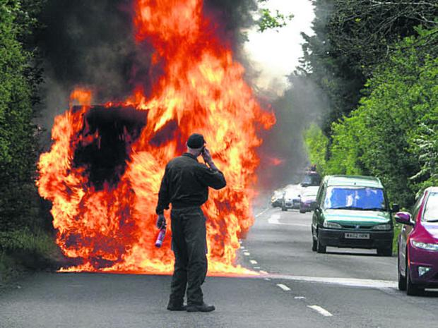 This Is Wiltshire: A van burns on the A420 today. Picture by Giles Hacon