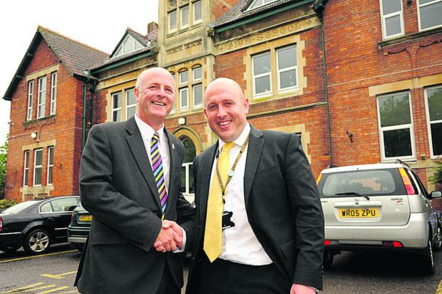 This Is Wiltshire: Outgoing John of Gaunt headteacher Andy Packer with soon-to-be new head Mike Gunston. Photo: Trevor