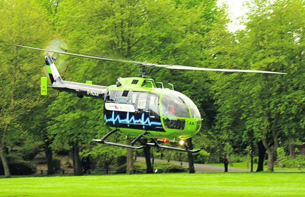 This Is Wiltshire: The Great Western Air Ambulance comes in to land in Trowbridge Park yesterday. Picture by Trevor Porte