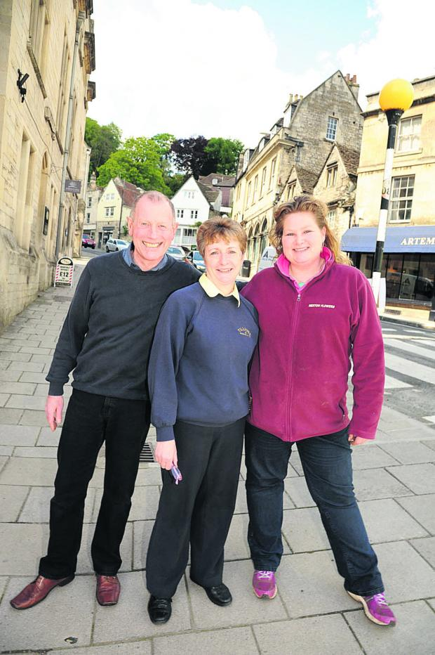 This Is Wiltshire: Market street in Bradford on Avon has reopened to the  delight of shop owners  Philip Brandenburg, Caroline Pilpott and Jacqui Mehrez.                Photo: Trevor Porter (48787)
