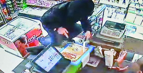 This Is Wiltshire: CCTV footage of a man trying to rob Juniper shop