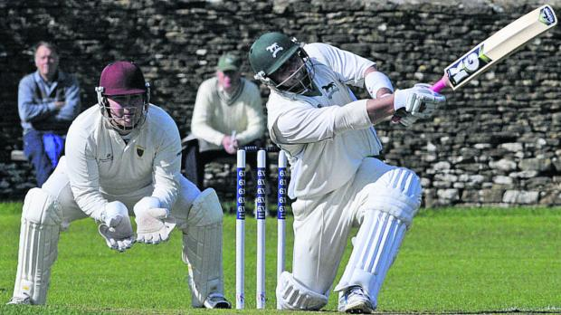 This Is Wiltshire: Wiltshire's Joe Breet hits another boundary during Sunday's win over Cornwall, watched by wicketkeeper Paul Smith