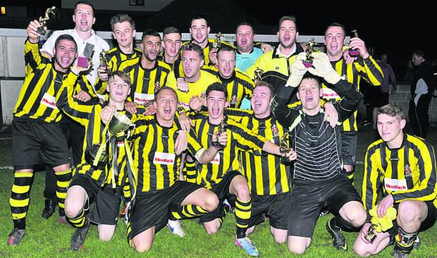 This Is Wiltshire: Trowbridge Town Reserves celebrate after clinching the Spring Cup last Friday night