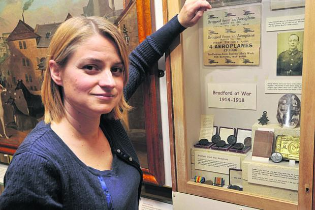 This Is Wiltshire: Bradford on Avon Museum trustee Kate Turnbull with their current, rather sparse, selection of First World War exhibits