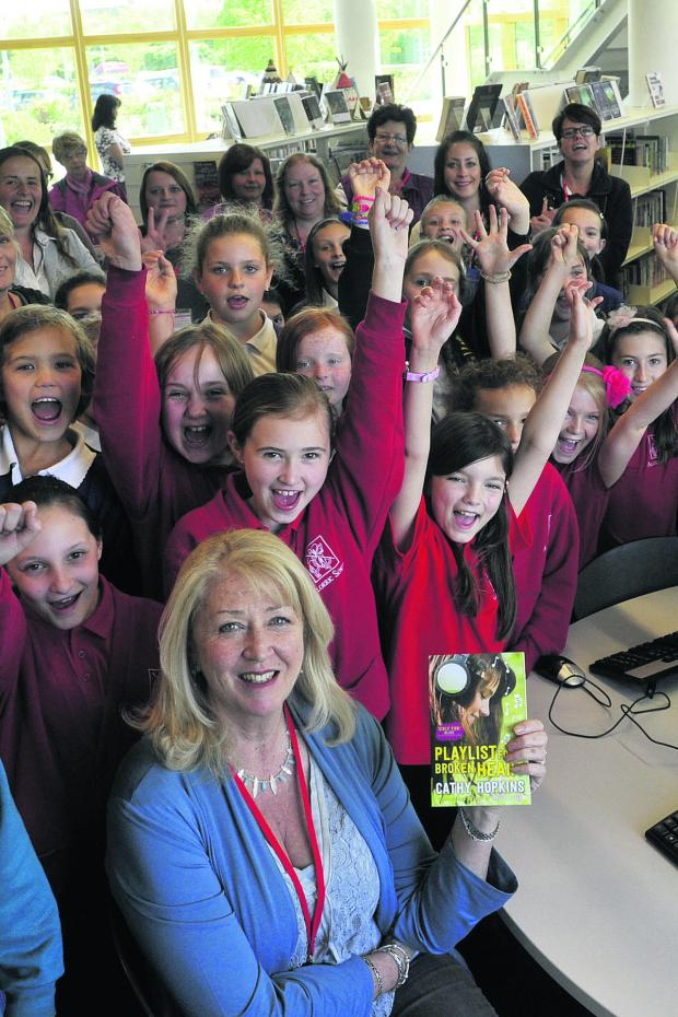 This Is Wiltshire: Cathy Hopkins with a delighted group of pupils who were thrilled to meet one of their favourite authors