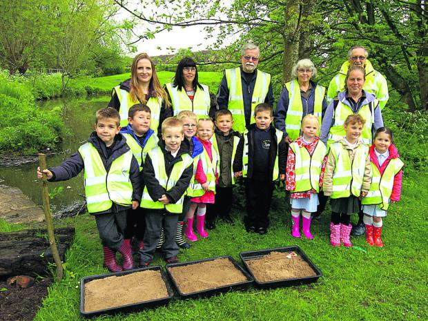 This Is Wiltshire: The Friends of Abberd Brook with staff and children from Priestley Primary School sowing poppies. (PM1224) By Paul Morris