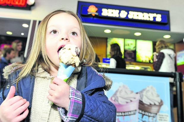 This Is Wiltshire: Paris-Capri enjoys an ice cream at Empire Cinema, in Greenbridge, which held a free cone day to help raise money for Prospect Hospice