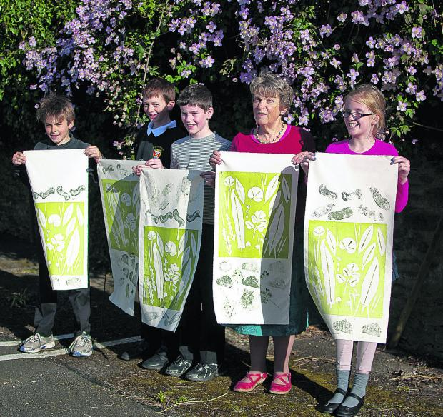 This Is Wiltshire: William Hulme, Edgar Nicolas, William Jacques, Heather Martin and Tilly Egerton with legacy banners created for the Wild Sherston event