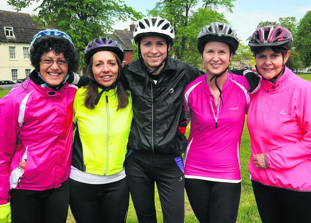 This Is Wiltshire: Five women are riding 100km from Windsor to London and back for cancer charities. Pictured are Geraldine Marsh, Tracey Kamei, Claire Francis, Louise Hale and Julie Pennell                   (VS355) By Vicky Scipio