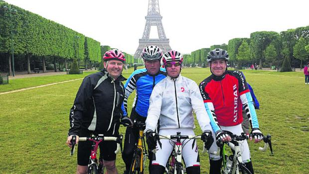 This Is Wiltshire: Fundraising father Stephen Baker, second left, arriving within sight of the Eiffel Tower in the centre of Paris on his sponsored bicycle ride with, from left, Kevan Haines, Gary Harris and Paul Rumming