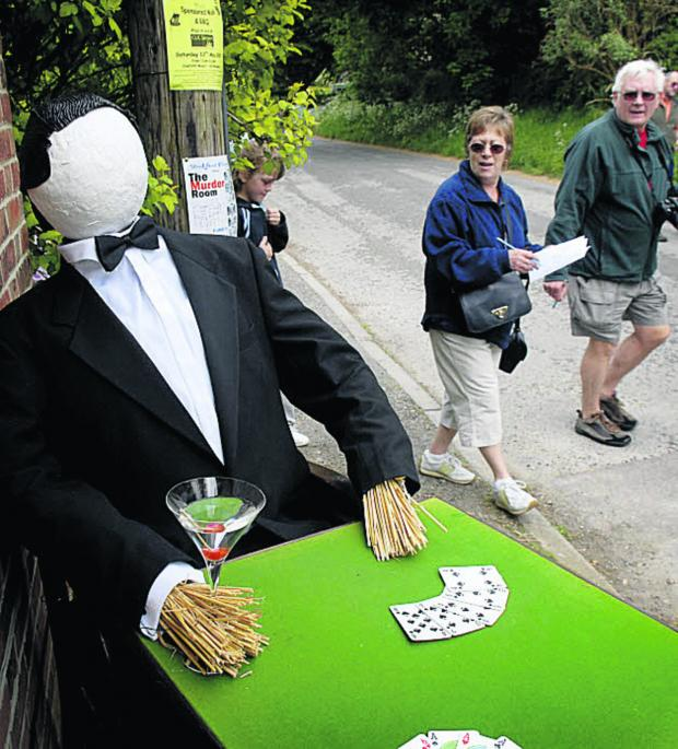 This Is Wiltshire: James Bond attracts attention in Urchfont's 2007 scarecrow festival