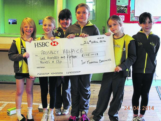 This Is Wiltshire: Cheque mates – 1st Moredon Brownies with the results of their fundraising efforts