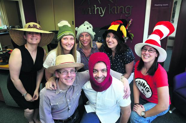 This Is Wiltshire: Withy King staff don their hats as part of their fundraising day to raise money for Headway in Swindon