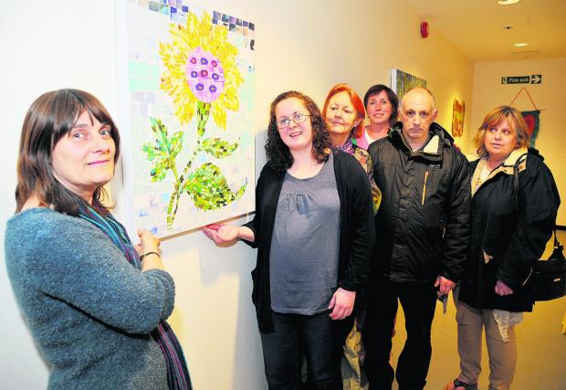 This Is Wiltshire: Artwork by mental health patients is unveiled at Chatsworth House to mark Mental Health Awareness Week. From left, social worker Penny Errill, Victoria Queen, Chris Dunn, Phyllida Richards, Mark Cameron and Val Denning