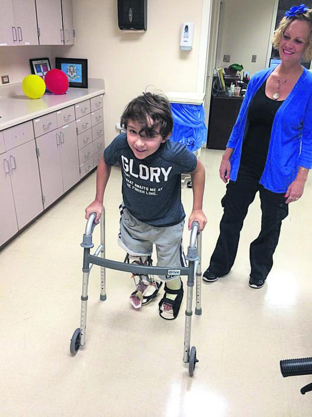 This Is Wiltshire: Luca Railton takes his first steps since his life-changing operation seven weeks ago