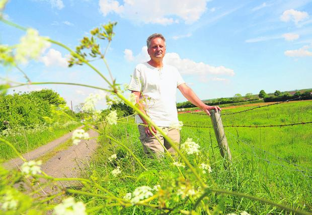 This Is Wiltshire: Kevin Fisher, chair of Shaw residents association at the site of an archaeological find at Ridgeway Farm construction site