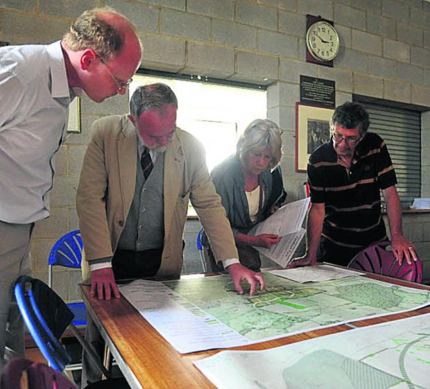 This Is Wiltshire: Edward Barham, second from left, talks about Robert Hitchins' plans at Kington Langley Village Hall