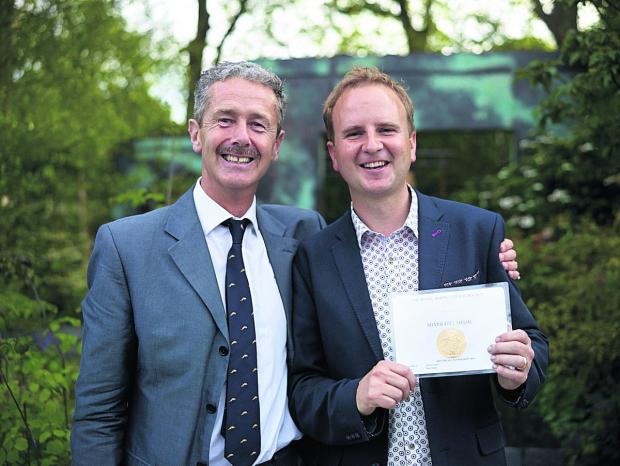 This Is Wiltshire: Rupert Tyler, national director of Brewin Dolphin, and Matthew Childs, who designed the firm's Chelsea Flower Show silver gilt medal-winning garden