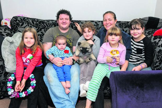 This Is Wiltshire: Zenek with his dad and sisters, pictured last summer. From the left, Zefiryna, dad Alun with baby Zenek, Anastazja, the family's Rainbow Trust support worker Oonagh with bone marrow donor Katarzyna, and Magdalena