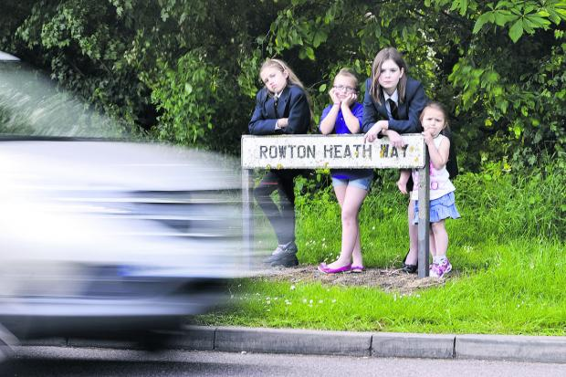 This Is Wiltshire: Cars are dodging the diversions around Whitehill Way, causing problems for students to safely walk to and from school. From left, local schoolchildren Mollie Aplin, Phoebe Aplin, Amber Traynor and Roxanne Aplin