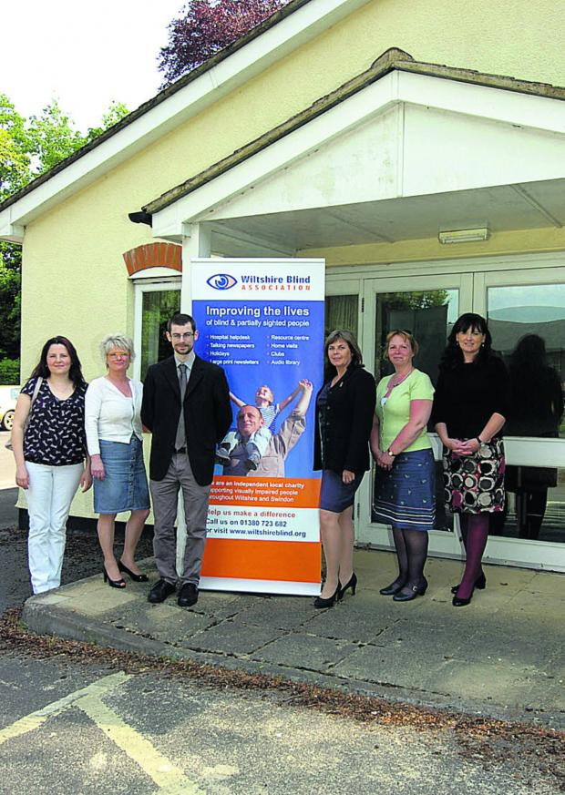 This Is Wiltshire: Wiltshire Blind Association outside its new headquarters. From left, Julia Shaw, Maggie Hemmings, Tom Cooper, Annie Davis, Theresa McMordie and Alison Forrest outside the former register office in Devizes