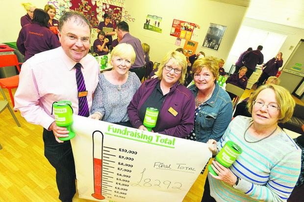 This Is Wiltshire: Sainsbury's presenting a cheque for £4,277 to the Samaritans – from left, Richard Hopkins, Linda Perry, Sue Sainsbury, Anne Ferguson and Linda Morgan