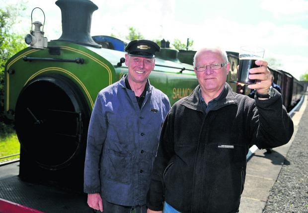 This Is Wiltshire: Jim Croton, left, and Tony Norris celebrate the success of last year's Swindon and Cricklade Railway Real Ale and Cider Festival