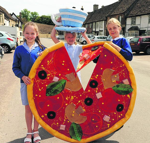 This Is Wiltshire: Lacock School pupils Charlotte, Erin and Olivia with some of the creations for the bank holiday scarecrow trail