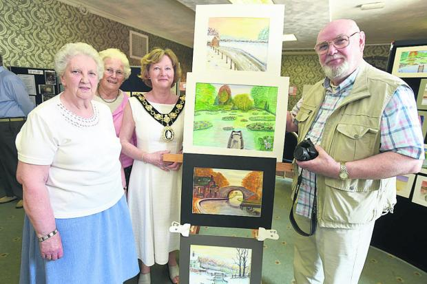 This Is Wiltshire: Doreen Ward, Brenda Hooper, Calne mayor Heather Canfer and artist Jeff Gibbons admire the work of dementia patients