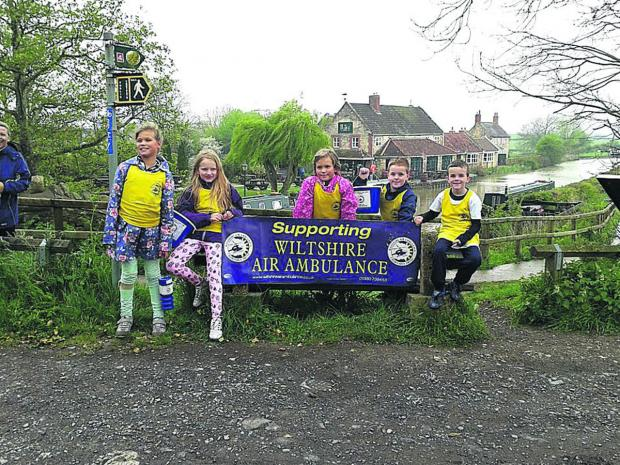 This Is Wiltshire: From left, Bowerhill School sponsored walkers Niamh Sayer, Abbie Craig, Phoebe Sayer, Ben Phillips, all nine, and seven-year-old Jamie Phillips pictured at the end of their walk along the Kennet and Avon canal.