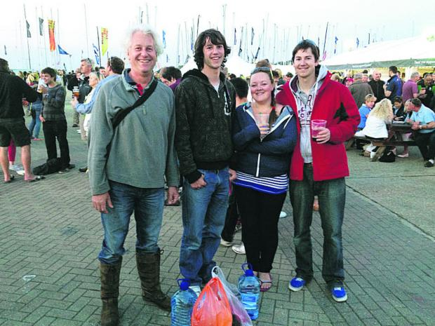 This Is Wiltshire: Neil Collings, left, with son Marcus, Sophie Starkie and Neil's other son, Graeme