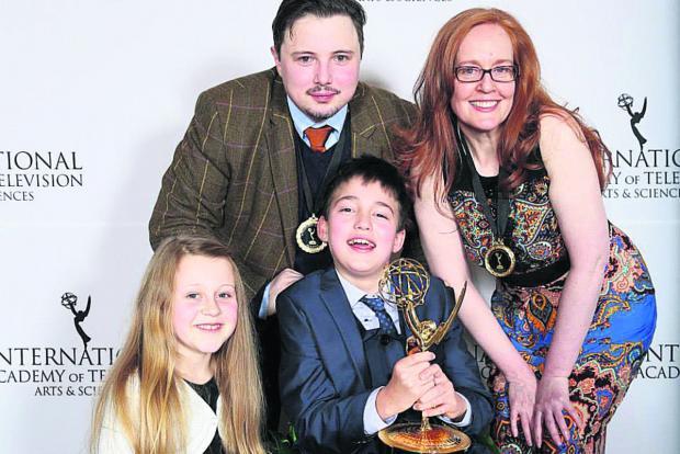 This Is Wiltshire: Phoebe Maddison left, at the Second International Emmy Kids Awards where she won a gong for her part in Same But Different