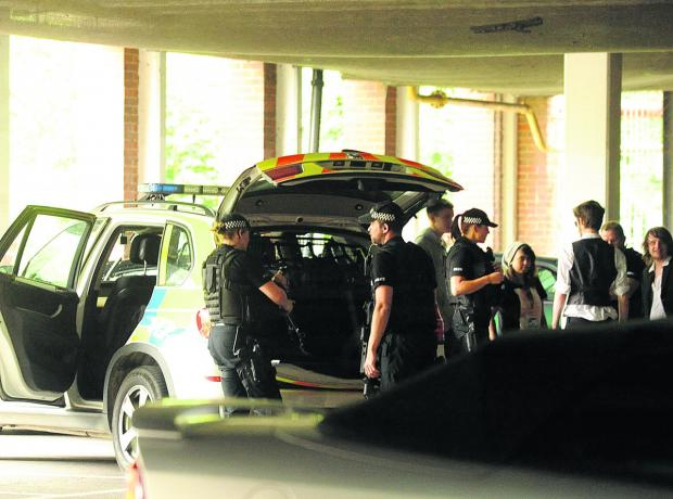 This Is Wiltshire: Armed police question the film students in the underground car park