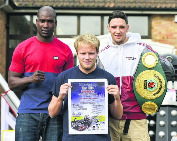 This Is Wiltshire: Boxers added some punch to a young people back to work event at John Moulton Hall, Penhill. Pictured, left to right, are Lawrence Bennett, South Area Cruiser Weight Champion, Aaron Webb, youth worker and boxer Kelvin Young