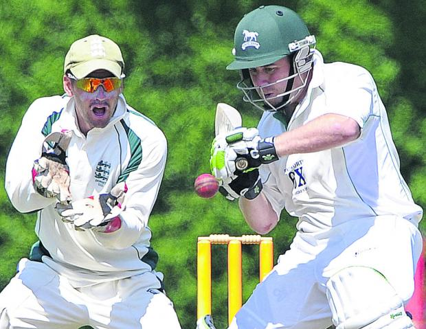 This Is Wiltshire: Wiltshire's James Hayward is watched by Dorset wicketkeeper Chris Park during Sunday's match in Bournemouth