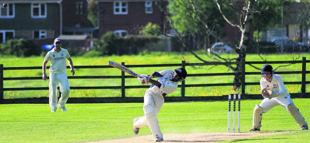 This Is Wiltshire: Potterne's Luke De Souza hits one of six sixes during his innings of 71 against Bath on Sunday (Picture: Johnathan Rose)