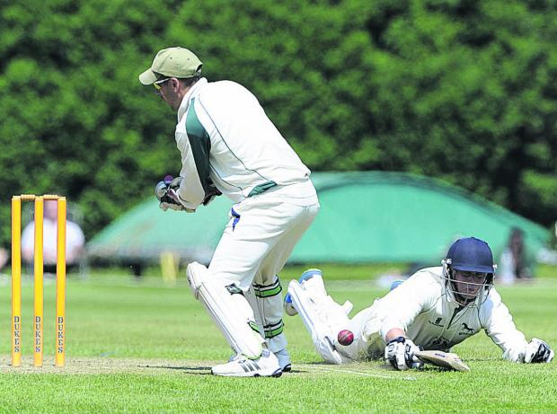 This Is Wiltshire: Wiltshire's top scorer Neil Clark just makes his ground as Dorset wicketkeeper Chris Park fails to hold a throw during Sunday's Trophy clash (Photo: Denis Murhpy)