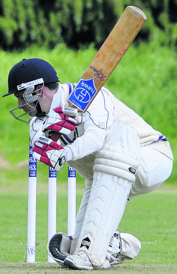 This Is Wiltshire: Marlborough batsman Dylan Bennie hits a boundary on his way to a century in his side's victory at Trowbridge on Saturday