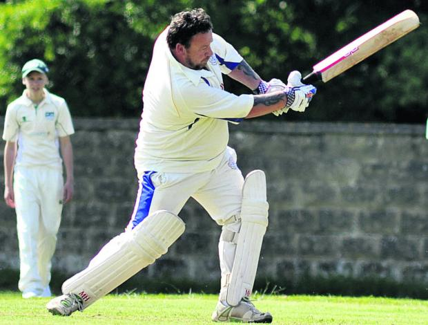 This Is Wiltshire: Beanacre & Melksham 2nd batsman Dean Wallingford hits out during his side's 54-run victory over Seagry in Division Three on Saturday