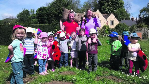 This Is Wiltshire: Seagry Pre-school children have been training alongside parents for the Tetbury Woolsack Race. They are watched over by Fayme Knight and Vanessa Davies