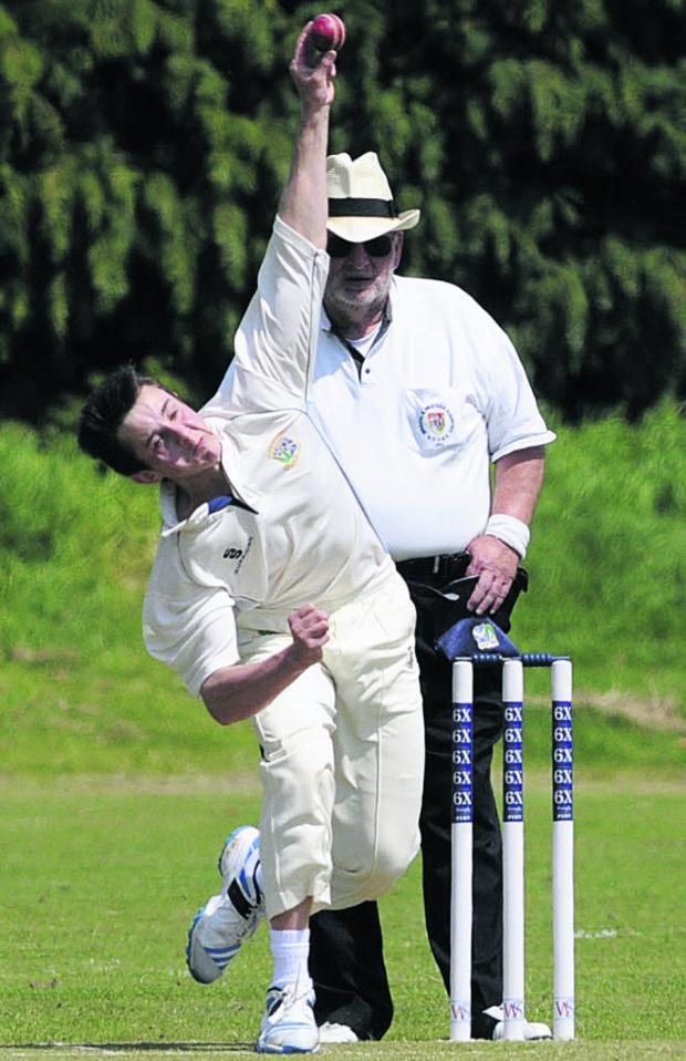 This Is Wiltshire: Trowbridge's Luke Seymour bowls during Saturday's defeat against Marlborough