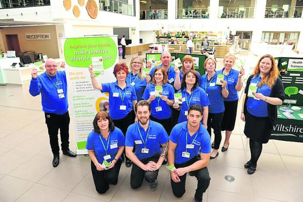 This Is Wiltshire: Senior health trainer Dave Payne, left, with his team at the launch at County Hall