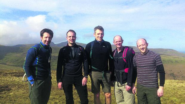 This Is Wiltshire: From left, Dan Jones, James Vaughton, John Fuggle, Dave Joyce and Tom Vaughton, training on the Brecon Beacons ahead of their challenge next month