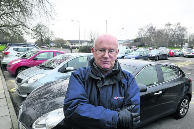 This Is Wiltshire: Car parking campaigner John Fairbrother in the County Hall car park