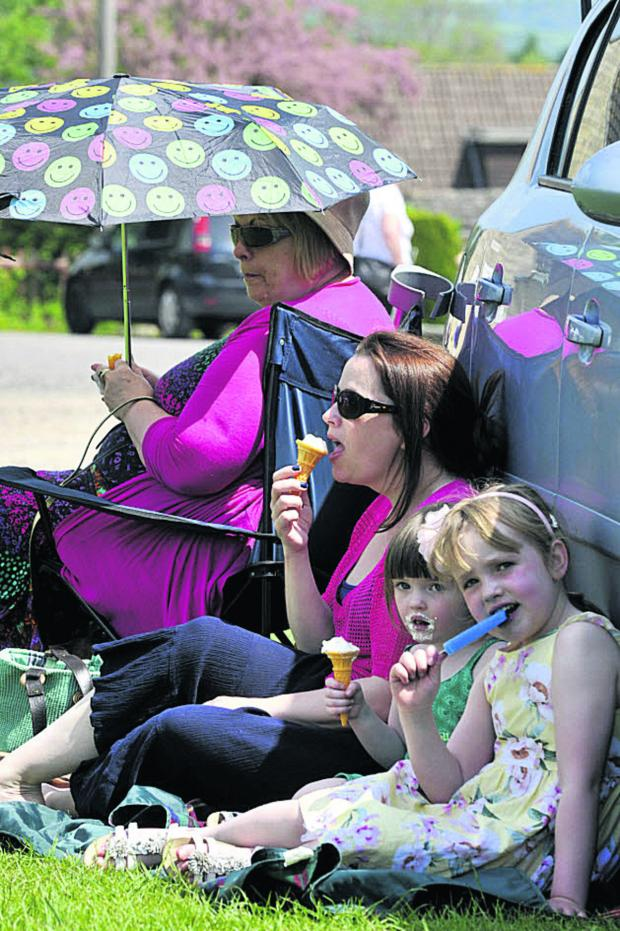 This Is Wiltshire: Shaw May Fair-goers  make a concerted effort to cool off