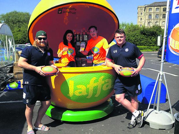 This Is Wiltshire: Bath players Ross Batty and David Wilson with Abbie Jackson and James Alford at the Jaffa stand